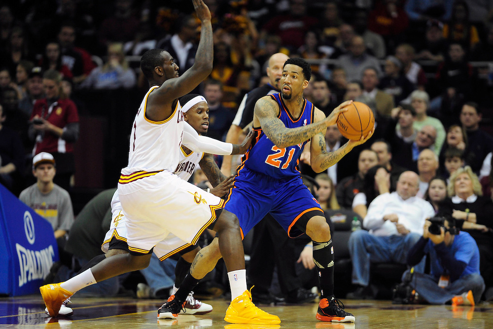 Dec. 18, 2010; Cleveland, OH, USA; Cleveland Cavaliers power forward J.J. Hickson (21) and point guard Daniel Gibson (1) put pressure on New York Knicks small forward Wilson Chandler (21)during the second quarter at Quicken Loans Arena. Mandatory Credit: Jason Miller-US PRESSWIRE