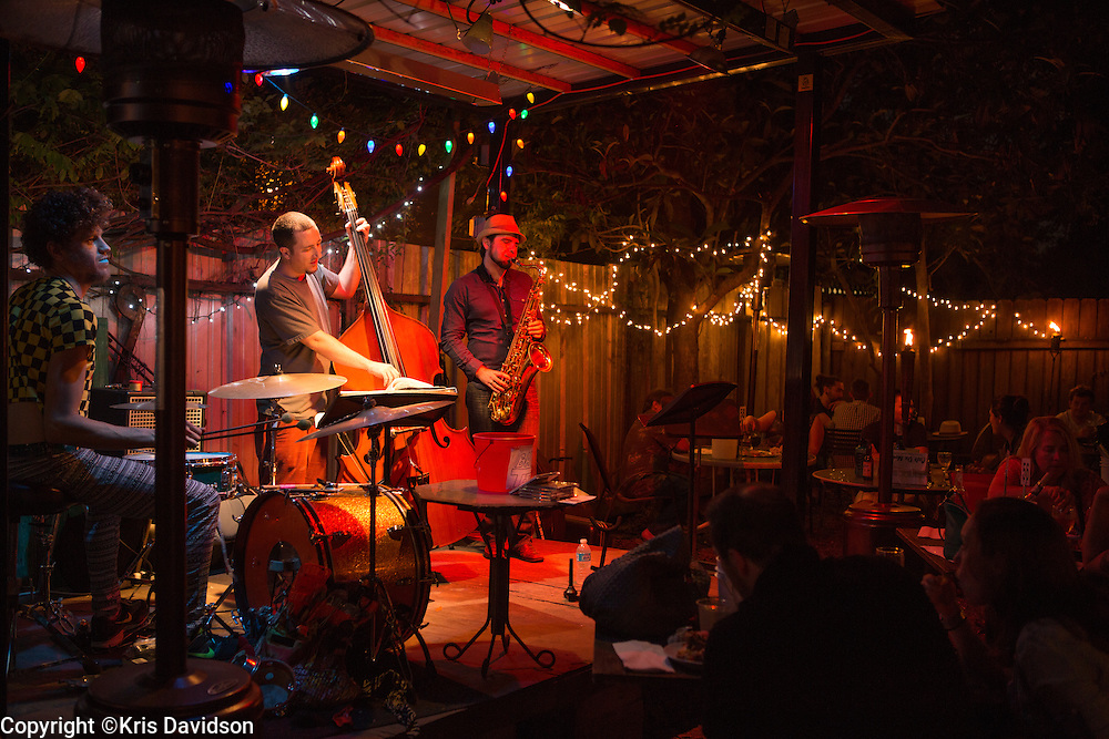 The Jesse Morrow Trio perform at Bacchanal. The backyard at Bacchanal in the Bywater (9th Ward) is always hopping any day of the week, weather permitting. Patrons buy wine in the wine shop up front and head to the back to enjoy great jazz.