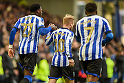 Dominic Iorfa of Sheffield Wednesday and Sheffield Wednesday vice captain Barry Bannan celebrating their team's first goal during the EFL Sky Bet Championship match between Sheffield Wednesday and Bristol City at Hillsborough, Sheffield, England on 22 December 2019.