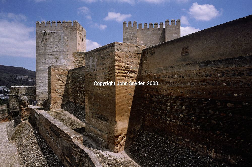 """Midday light reveals myriad facets of the walls of the Alhambra, meaning """"red castle"""" in Arabic, in Granada--fortress and last home of the Moors before being expelled from Spain."""