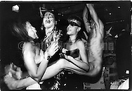 June 15, 1988:  A nude man swings from the ceiling with a group of clubgoers having fun at the Celebrity Club at Tunnel nightclub in New York City, New York.