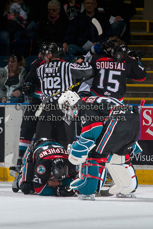 KELOWNA, CANADA - OCTOBER 26: Michael Herringer #30 stands above Devante Stephens #21 of the Kelowna Rockets after a check into the boards by Victoria Royals during first period on October 26, 2016 at Prospera Place in Kelowna, British Columbia, Canada.  (Photo by Marissa Baecker/Shoot the Breeze)  *** Local Caption ***