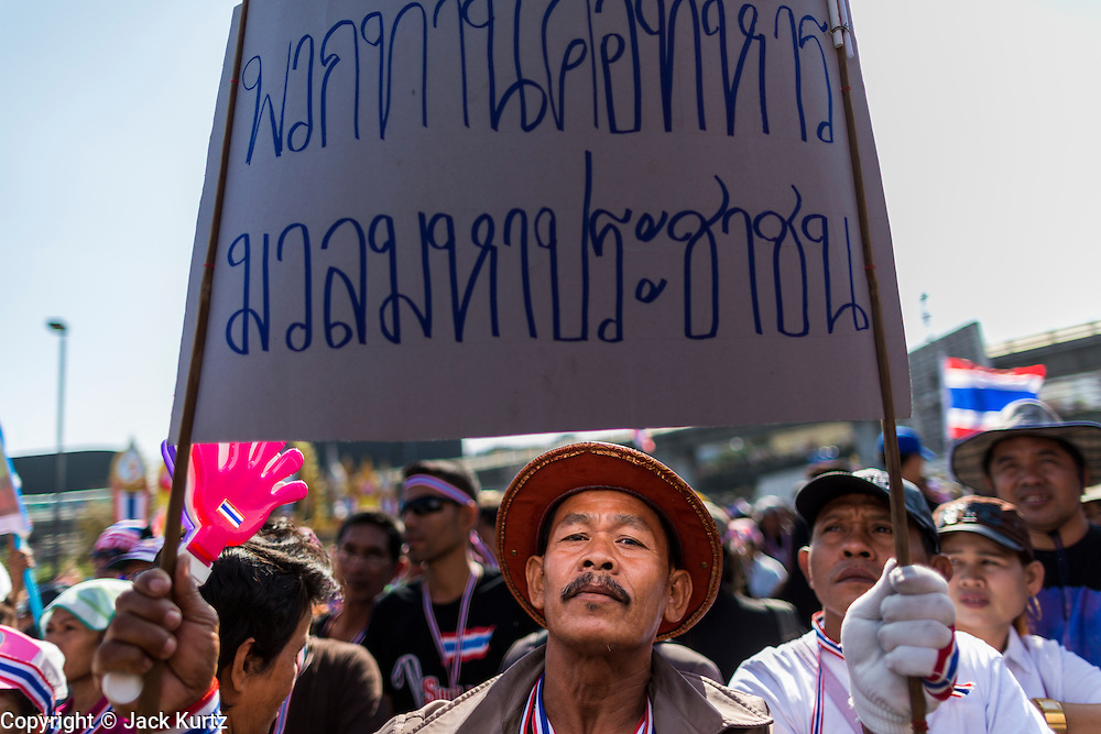 "14 JANUARY 2014 - BANGKOK, THAILAND:  Thai anti-government protestors at Victory Monument. Tens of thousands of Thai anti-government protestors continued to block the streets of Bangkok Tuesday to shut down the Thai capitol. The protest, ""Shutdown Bangkok,"" is expected to last at least a week. Shutdown Bangkok is organized by People's Democratic Reform Committee (PRDC). It's a continuation of protests that started in early November. There have been shootings almost every night at different protests sites around Bangkok, but so far Shutdown Bangkok has been peaceful. The malls in Bangkok are still open but many other businesses are closed and mass transit is swamped with both protestors and people who had to use mass transit because the roads were blocked.    PHOTO BY JACK KURTZ"