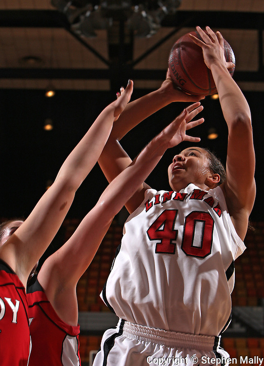 Linn-Mar's Kiah Stokes (40) shoots over the defenders during their Rivalry Saturday game at the US Cellular Center in Cedar Rapids on Saturday January 2, 2010. Linn-Mar defeated Assumption 52-48. (Stephen Mally/Freelance)