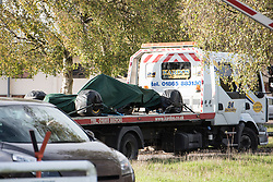 © Licensed to London News Pictures. 31/10/2014. Caterham F1 Leafield, Oxfordshire. An F1 on a low loader was driven into the Caterham F1 site. Caterham F1 employees were called into work today but had to leave their cars outside on the road and pass through security to enter the F1 HQ at Leafield. The F1 team is now in Administration and will not be at the next two Grand Prix at Texas is the USA and Interlagos in Brazil. two F1 teams are now in administration caterham F1 and Marussia both based in Oxfordshire. Photo credit : MARK HEMSWORTH/LNP