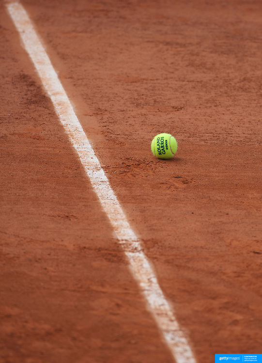 A tennis ball on the clay surface of Roland Garros during practice before the start of the French Open Tennis Tournament in Paris, France on Saturday, May 23, 2009. Photo  Tim Clayton.