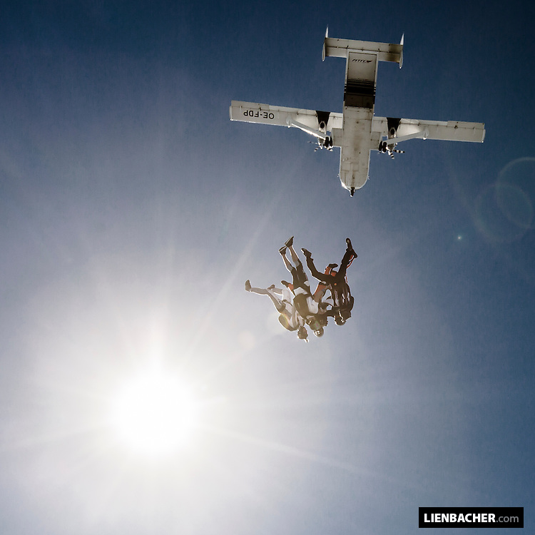 skydivers performing 6 way headdown exit from a skyvan