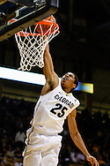 November 16th, 2013:  Colorado Buffaloes junior guard Spencer Dinwiddie (25) finishes a fast break with a dunk in the second half of the NCAA Basketball game between the Jackson State Tigers and the University of Colorado Buffaloes at the Coors Events Center in Boulder, Colorado