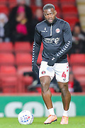 Charlton Athletic defender Adedeji Oshilaja (4) warms up prior to the EFL Sky Bet Championship match between Charlton Athletic and Hull City at The Valley, London, England on 13 December 2019.
