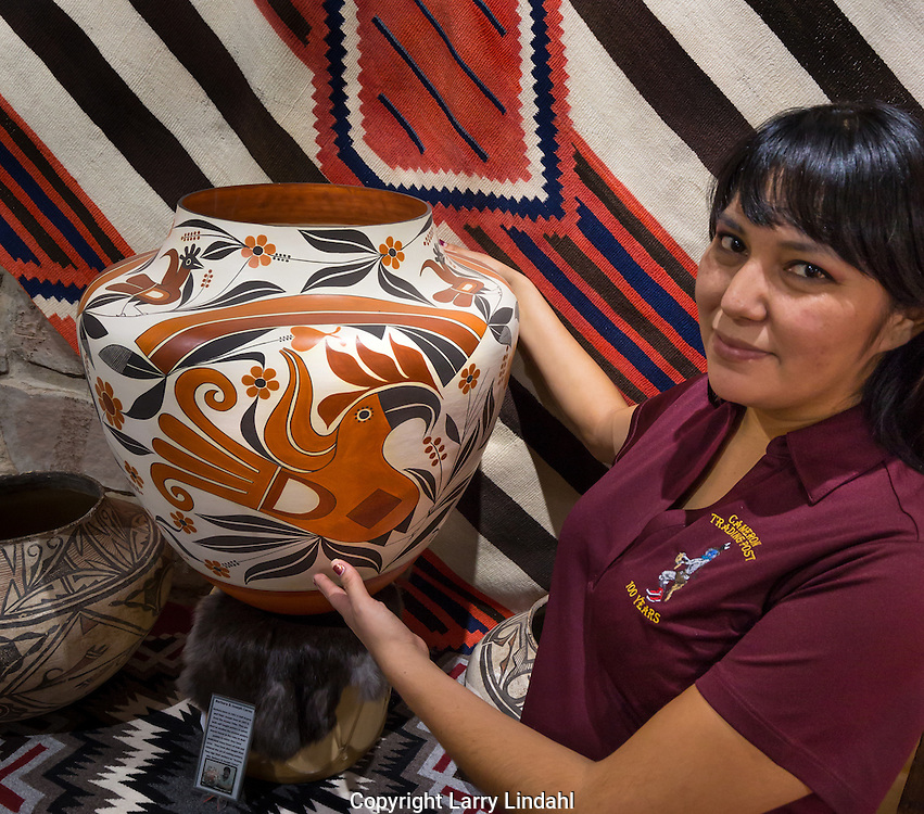 Savannah Means shows a Acoma pot at The Gallery, Cameron Trading Post, Cameron, Arizona
