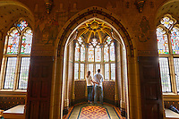 Couple looking at window in Banqueting Hall<br /> Cardiff Castle<br /> Cardiff<br /> South<br /> Historic Sites