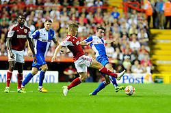 Bristol City's Joe Bryan and Bristol Rovers' Michael Smith contend for the ball  - Photo mandatory by-line: Dougie Allward/JMP - Tel: Mobile: 07966 386802 04/09/2013 - SPORT - FOOTBALL -  Ashton Gate - Bristol - Bristol City V Bristol Rovers - Johnstone Paint Trophy - First Round - Bristol Derby