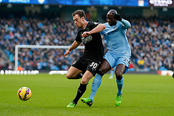 Ashley Barnes of Burnley is challenged by Eliaquim Mangala of Manchester City - Photo mandatory by-line: Rogan Thomson/JMP - 07966 386802 - 28/12/2014 - SPORT - FOOTBALL - Manchester, England - Etihad Stadium - Manchester City v Burnley - Barclays Premier League.