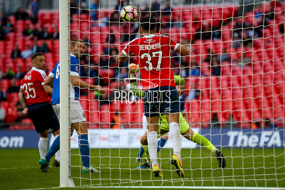 York City midfielder, on loan from Cheltenham Town, Asa Hall (17)  clears the ball off the line during the FA Trophy match between Macclesfield Town and York City at Wembley Stadium, London, England on 21 May 2017. Photo by Simon Davies.
