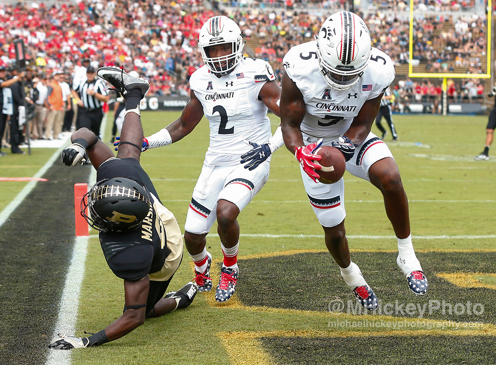 WEST LAFAYETTE, IN - SEPTEMBER 10:  Bilal Marshall #3 of the Purdue Boilermakers falls to the ground as Mike Tyson #5 of the Cincinnati Bearcats makes the interception in the end zone at Ross-Ade Stadium on September 10, 2016 in West Lafayette, Indiana.  (Photo by Michael Hickey/Getty Images) *** Local Caption *** Bilal Marshall; Mike Tyson