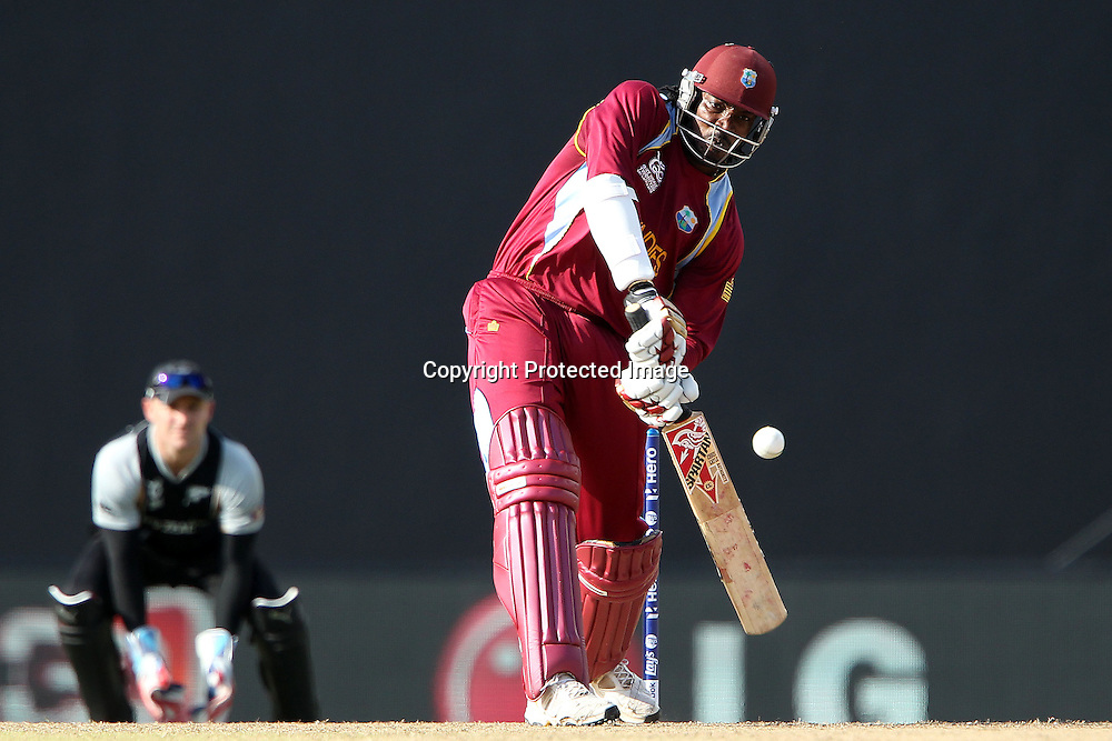 Chris Gayle of The West Indies knocks Jacob Oram for four during the ICC World Twenty20 Super Eights match between The West Indies and New Zealand held at the  Pallekele Stadium in Kandy, Sri Lanka on the 1st October 2012<br /> <br /> Photo by Ron Gaunt/SPORTZPICS/PHOTOSPORT