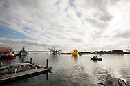A giant rubber duck,  the brainchild of Dutch artist Florentijn Hofman's six-story-tall floating ``Rubber Duck'' sculpture, passes under the Vincent Thomas Bridge, arrival at Port of Los Angeles, Wednesday August 20, 2014.(Photo by Ringo Chiu/PHOTOFORMULA.com)