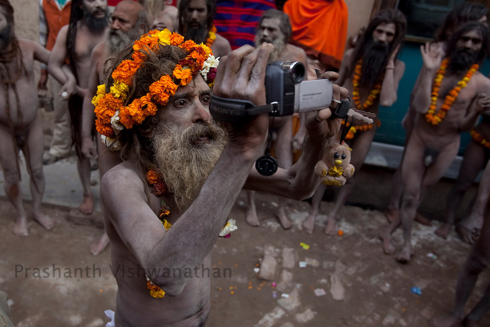 "A Naga sadhu holds a Sony video camera during the ""Shahi Snan"" (royal bath) during the Maha Kumbh ceremony in Haridwar, February 12, 2010.  Photographer:Prashanth Vishwanathan"