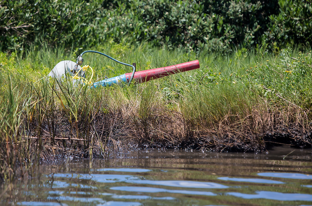 Noise machine in the marsh used to scare birds away from the oil spill. An estimated 4,200 gallons of crude oil attributed to oil and gas extraction company Hilcorp spilled in the marsh near Lake Grande Ecaille, part of Barataria Bay, on July 25.