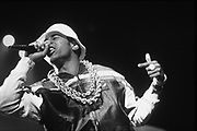 Rapper in gold chains performing on stage, UK, 1980s