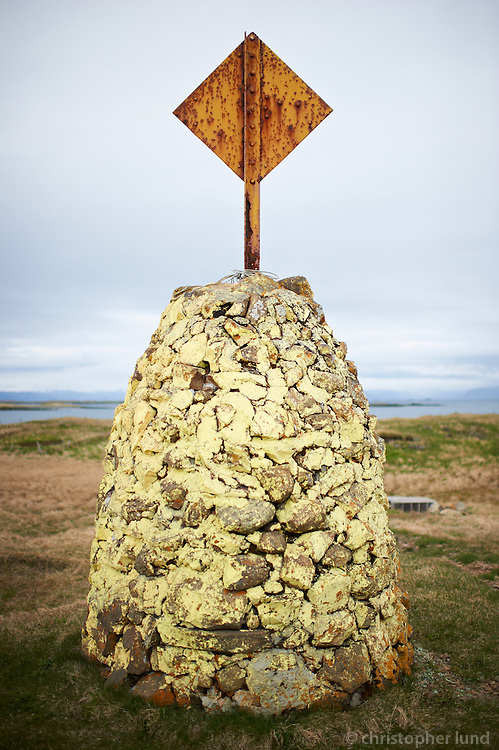 A scene from island Flatey, Iceland. A navigation signal. Flatey is the largest island of the western island, a cluster of about forty large and small islands and islets located in Breiðafjörður on the northwestern part of Iceland.