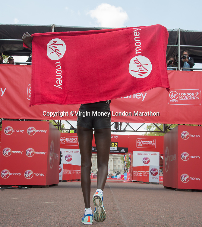 Mary Keitany KEN&nbsp;celebrates her win and her new World Record in the Elite Women&rsquo;s Race. The Virgin Money London Marathon, 23rd April 2017.<br /> <br /> Photo: Roger Allen for Virgin Money London Marathon<br /> <br /> For further information: media@londonmarathonevents.co.uk