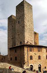 Viewed from the steps of the Collegiata Cathedral, the Paltoni-Salvucci Palace and its twin towers seem to dominate San Gimignano.