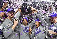 Players of the Kansas State Wildcats celebrate after winning the Big 12 Regular Season Title at Bramlage Coliseum in Manhattan, Kansas.