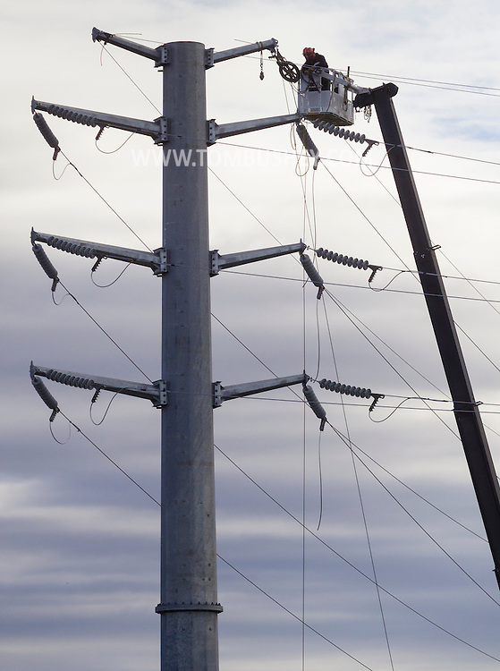 Goshen, New York  - Workers from Northline Utilities connect transmission wires on a tower at Orange & Rockland's new substation in Goshen on Oct. 24, 2014.