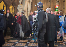© Licensed to London News Pictures.22/03/2017. London, UK. MP's are seen next to an armed policeman  during a lockdown in the Central Lobby in Parliament after a terrorist attack in which a policeman and a woman have been killed.Photo credit: Alison Baskerville/LNP