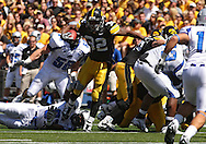 September 4 2010: Iowa Hawkeyes running back Adam Robinson (32) tries to pull away from a defender during the third quarter of the NCAA football game between the Eastern Illinois Panthers and the Iowa Hawkeyes at Kinnick Stadium in Iowa City, Iowa on Saturday September 4, 2010. Iowa defeated Eastern Illinois 37-7.
