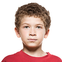 little caucasian boy portrait blank expression isolated studio on white background