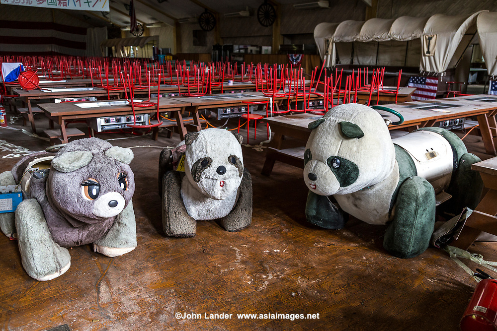 Western Village Haikyo, Abandoned Stuffed Animals - <br /> Japan is a country associated with serene temples, exquisite gardens and cherry blossoms.  It is the last place you'd expect to a Wild West theme park.  Perhaps that is why it officially closed down to the public in 2007, but is still popular with explorers who still go there and try to imagine what it was like to travel back in time to the American Wild West for the afternoon amidst all the rubble, saloons and fading attractions.  It now more closely resembles a horror movie movie set, but never mind.  The place is fascinating on so many levels, that if visitors happen to be in the Nikko area, it is definitely a must, at least get a gander of the replica Mount Rushmore mountain as the train passes by.  If you dare to enter (it is officially off limits but has easy access) you may be either creeped out by all the dishevelment and weeds or you may find yourself fascinated.  It&rsquo;s at your own risk, but true aficionados of haikyo, abandoned buildings and theme parks will be unable to resist.