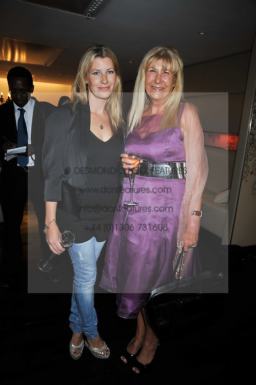 Left to right, SARA PARKER BOWLES and her mother CAROLINE BUYS at the launch of Tom Parker Bowles's new book 'Full English' held in the Gallery Restaurant, Selfridges, Oxford Street, London on 9th September 2009.