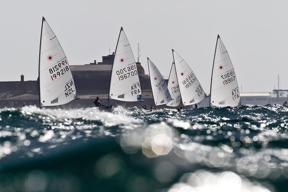 ENGLAND, Weymouth, 7th June 2011. Skandia Sail for Gold Regatta. The Laser fleet sails downwind.