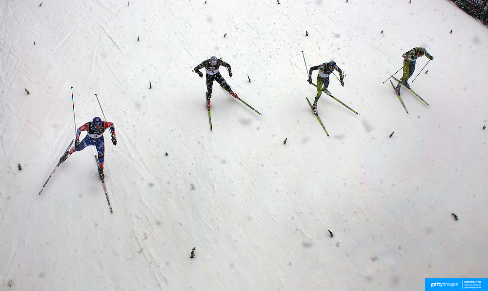 The start of the Quarter Final of the Men's Sprint Free, from left,  Nikita Kriukov, Russia, Kris Freeman, USA, Callum Watson, Australia and Phillip Bellingham, Australia, during the Cross Country Sprint Competition at Snow Farm, New Zealand during the Winter Games. Wanaka, New Zealand, 14th August 2011. Photo Tim Clayton