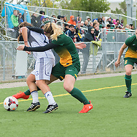 3rd year forward Brianna Wright (7) of the Regina Cougars makes a tackle during the Women's Soccer home game on September 11 at U of R Field. Credit: Arthur Ward/Arthur Images