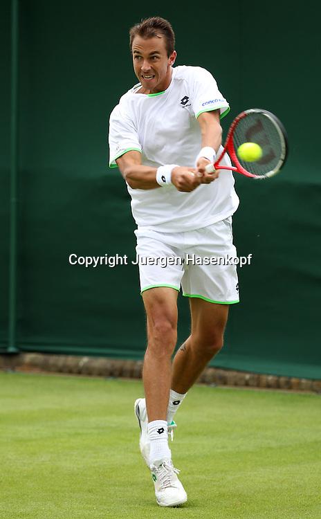 Wimbledon Championships 2013, AELTC,London,<br /> ITF Grand Slam Tennis Tournament, Lukas Rosol (CZE),Aktion,Einzelbild,Ganzkoerper,Hochformat,