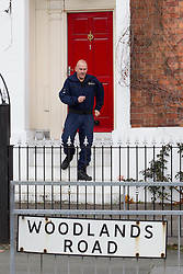 © Licensed to London News Pictures . 09/10/2012 . Altrincham , UK . Police leaving a property on Woodlands Road, Altrincham , Cheshire on October 9,2012 where a search continues following the arrest of Jimmy Savile's former chauffeur , Ray Teret , and housemate Alan Ledger , yesterday (8th November) over historic child rape allegations . Photo credit : Joel Goodman/LNP
