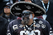 Oakland Raiders fans cheer on their team during a NFL game against the Carolina Panthers at Oakland Coliseum in Oakland, Calif., on November 27, 2016. (Stan Olszewski/Special to S.F. Examiner)