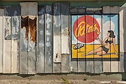 Sign painted on a rusting metal wall for Rita's seaside restaurant in Folly Beach, SC.