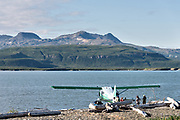 A float plane unloads passengers in the lagoon at the McNeil River State Game Sanctuary on the Kenai Peninsula, Alaska. The remote site is accessed only with a special permit and is the world's largest seasonal population of brown bears.