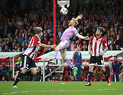 Paul McShane (Reading defender) getting fouled during the Sky Bet Championship match between Brentford and Reading at Griffin Park, London, England on 29 August 2015. Photo by Matthew Redman.