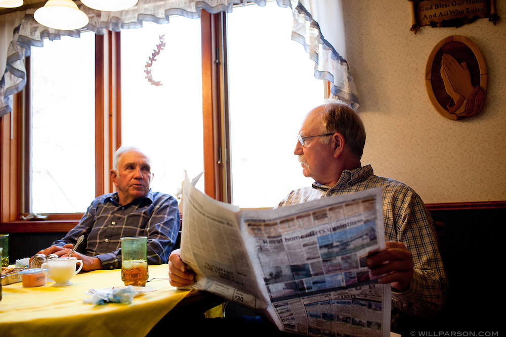 J Parson reads the Sunday paper in Mulberry, Kansas.