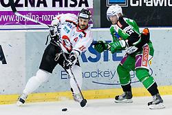 Petr Kanko (HC Znojmo Orli, #10) vs Tomi Mustonen (HDD Tilia Olimpija, #21) during ice-hockey match between HDD Tilia Olimpija and HC Znojmo Orli in 24th Round of EBEL league, on November 22, 2011 at Hala Tivoli, Ljubljana, Slovenia. HDD Tilia Olimpija won 5:2. (Photo By Matic Klansek Velej / Sportida)