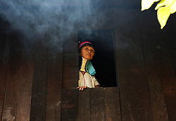 A Padaung woman with brass rings around her neck looks out of the window in Panpet Village, Demoso Township, Kayah State, Myanmar, April 11, 2016. The brass rings are first applied when the Padaung girls are about eight years old and as the girl grows older, longer coils are added up to 24 or 25 rings. EXPA Pictures © 2016, PhotoCredit: EXPA/ Photoshot/ U Aung<br /> <br /> *****ATTENTION - for AUT, SLO, CRO, SRB, BIH, MAZ, SUI only*****