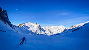 Skiing at La Mongie ski resort,  Bagnères-de-Bigorre, France. Pic du Midi de Bigorre is in the background.