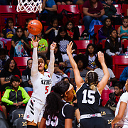 09 November 2018: San Diego State Aztecs guard Te'a Adams (5) takes a three point shot over Hawaii Warriors guard Jadynn Alexander (15) in the second quarter. The Aztecs opened up it's regular season schedule with a 58-57 win over Hawaii Friday at Viejas Arena.