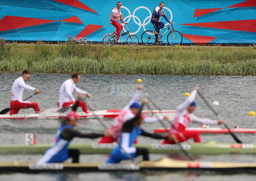 Coaches follow competitors on bicycles during the Men's Canoe Double (C2) 1000m at Eton Dorney during day 11 of the London Olympic Games in London, England, United Kingdom on August 7, 2012..(Jed Jacobsohn/for The New York Times)..