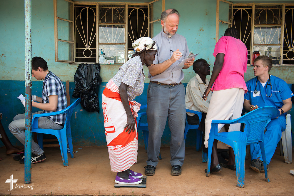 The Rev. Dr. John Juedes, pastor of Messiah Lutheran Church in Highland, Calif., takes vitals during the Mercy Medical Team clinic Thursday, June 12, 2014, at the Luanda Doho Primary School in Kakmega County, Kenya. LCMS Communications/Erik M. Lunsford